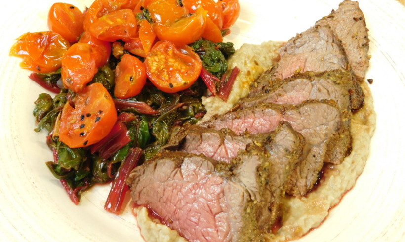 Spice-crusted beef fillet with baba ghanoush, cherry tomatoes and ruby chard