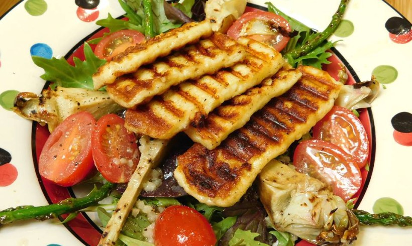 A grilled spring veg salad topped with haloumi