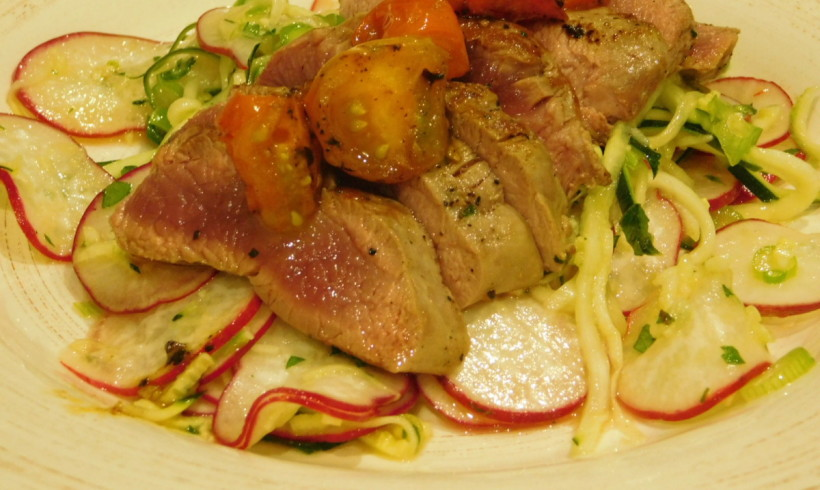 Wallaby fillet with caramelised tomato and raw zucchini salad