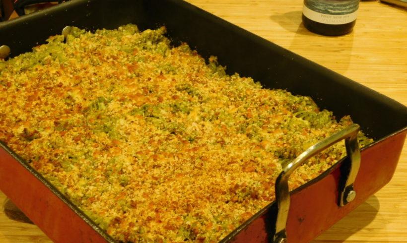 Baked pasta with kale pesto and bacon pangrattato