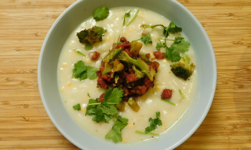 Corn & celeriac chowder with chorizo and broccoli garnish