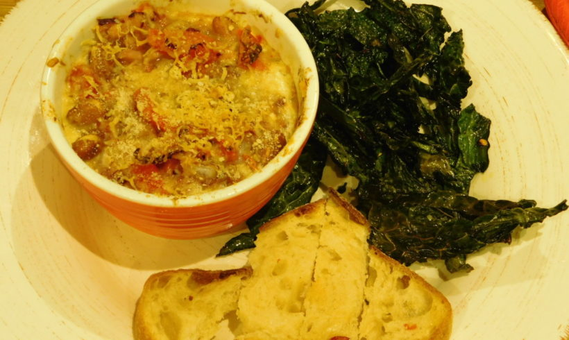 Baked eggs with borlotti beans and kale chips